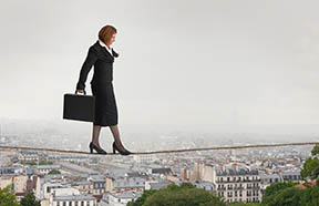 business woman on tightrope